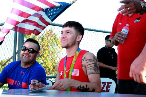 Olympic boxer Nico Hernandez attends first home football game