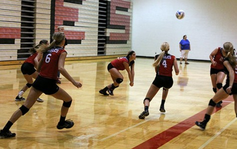 Senior Maddi Cumpston sets the ball while playing against Rose Hill. Photo by Jet *