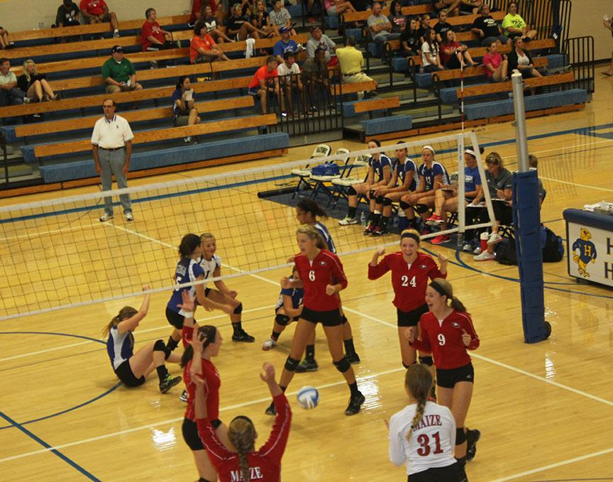 The Lady Eagles celebrate after scoring.