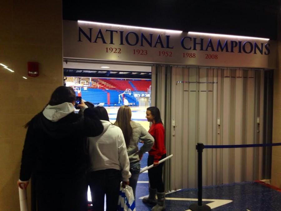 The girls basketball team watches the men's KU basketball team.