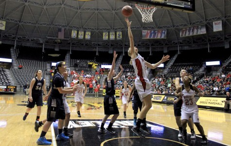 Girls advance to state semis behind Johnson's 21 points