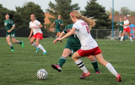Senior Becca Andrus, 8, tries to move past Salina South defense. Photo by Katie McLachlan.