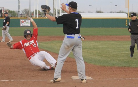 Brady Hoover slides in safely for a triple in Tuesday's victory over Hutchinson. Photo by Maite Menendez