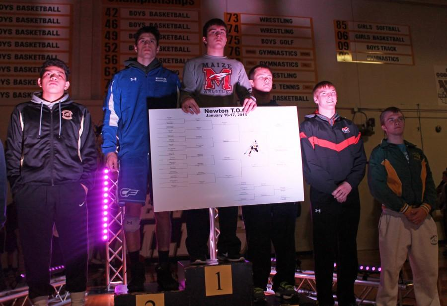 Undefeated junior Brett Moon stands on the podium after winning the Newton Tournament of Champions Saturday.