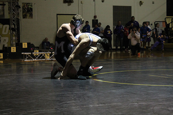 Junior Brett Moon defeats defending state champion Lucas Lovvorn of Holton at the Newton Tournament of Champions. Photo by Kalee Betzen.