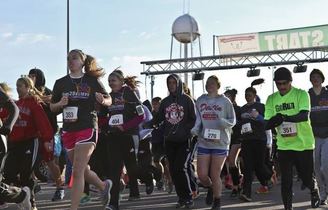 Participants take off from the starting line in the 2014 race. Photo submitted by Run 2 Believe.