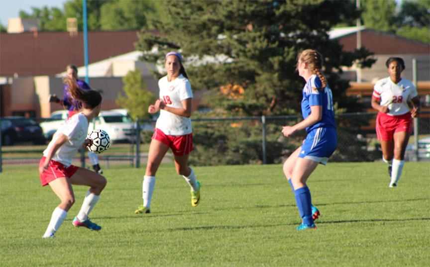 Junior Ashley Zane passes the ball to sophomore Makayla Toth. The girls will take on Trinity tomorrow at home.