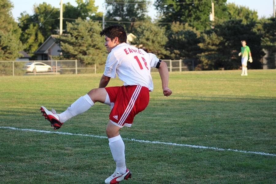 Senior Alan Sanchez takes a free kick during the Rose Hill game