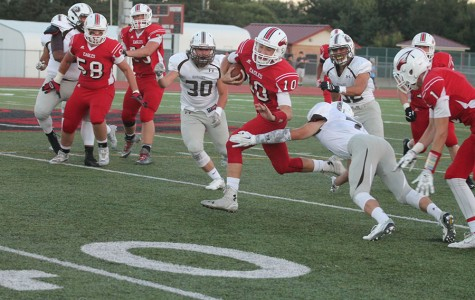 Sophomore  Brayden Payne runs the ball down field in the first half against Garden City.