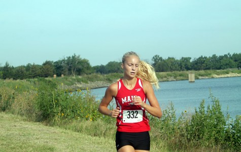 Boys cross country team places first at Emporia; girls place third