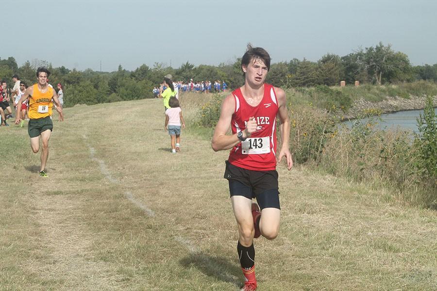 Junior Josh Christian runs at the Lake Afton meet. Christian ran a time of 18:00 at Rim Rock.