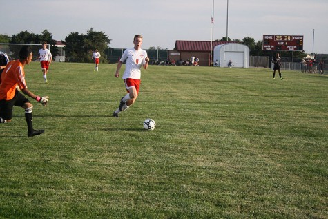 Connor Holmes Sprints for the ball during a game this season. The team lost its final game of the season to Andover 2-0.