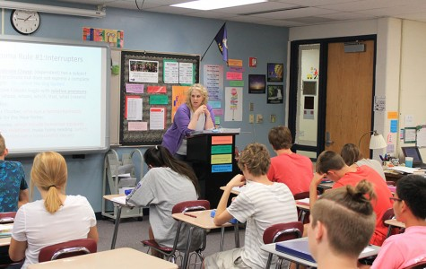 English teacher Jana Schantz talks to her class about correct comma usage.