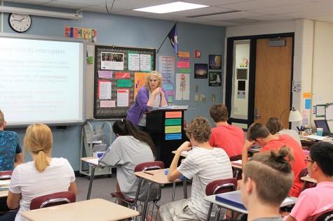 English teacher Jana Schantz talks to her class about correct comma usage.