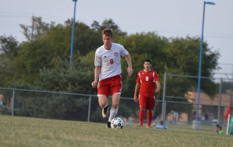 Senior Connor Holmes runs with the ball down field.