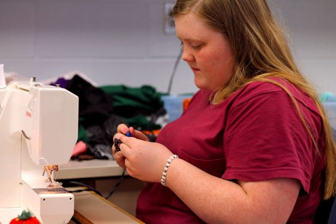 Emily Casteel works on a project in sewing I