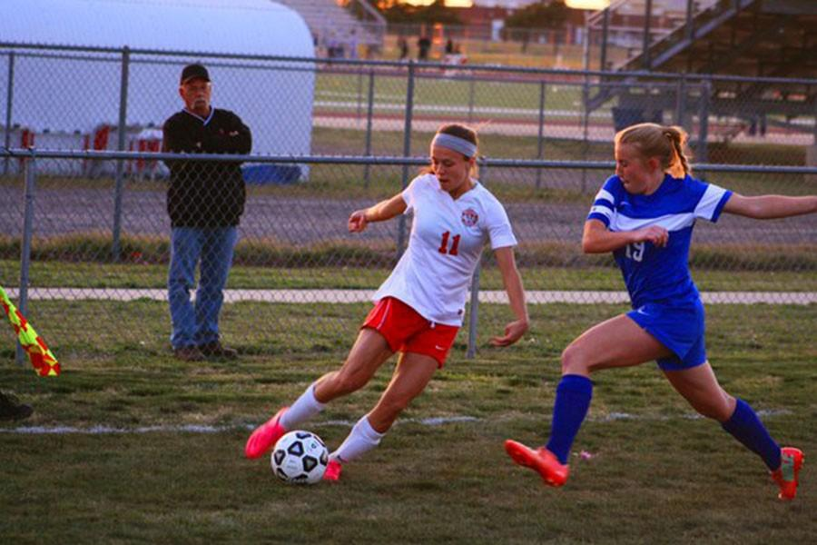 Junior Makayla Tooth kicks the ball against Andover. Picture taken from: Taylor Vonfeldt