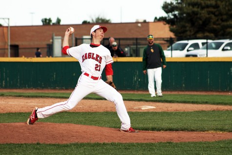 Junior Jake Doerflinger winds up for a pitch. Doerflinger pitched well in game two against Salina South, but the Eagles fell short.