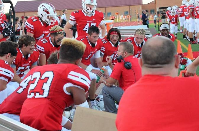 The football team huddles before their game against Newton. They won 49-27.