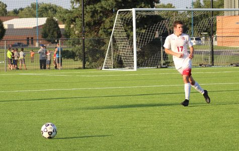 Sophomore Nick Reiswig kicks the ball up field. Soccer lost to Derby 2-1 Tuesday.
