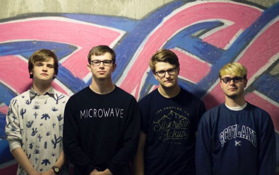 Gilchrist poses with band members (from left to right) Samuel Gilchirst, Trent Gaddie, Will Mercer and Scott Carver. Photo from Tideway's twitter page.