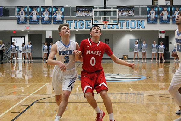 Sophomore Caleb Grill attempts to recover a rebound against Eisenhower defender Dylan Vincent.