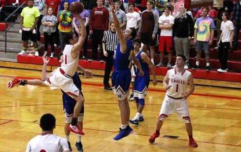 Boys basketball place third at McPherson