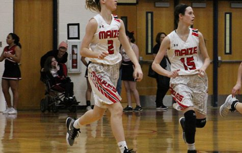 Senior Brecken Roe and sophomore Alexis Cauthon run down court. The Eagles defeated Derby 54-42.