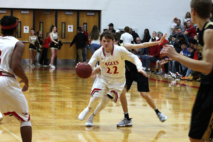 With the Eagles on offense, senior Kaden Jobe dribbles the ball down the court.