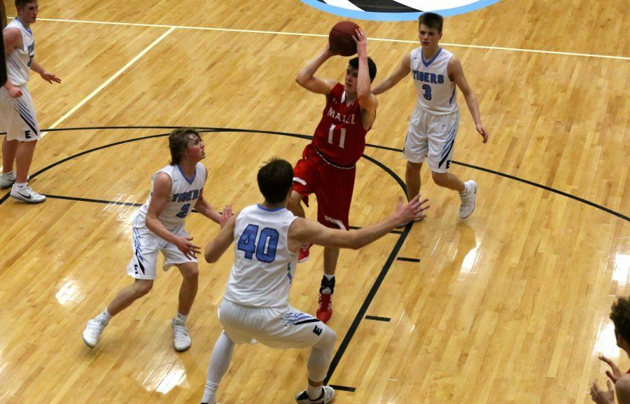Grant Bugbee goes up for a shot in the fourth quarter of Saturday's sub-state championship game at Eisenhower. The Eagles lost 52-44. Bugbee scored nine points.