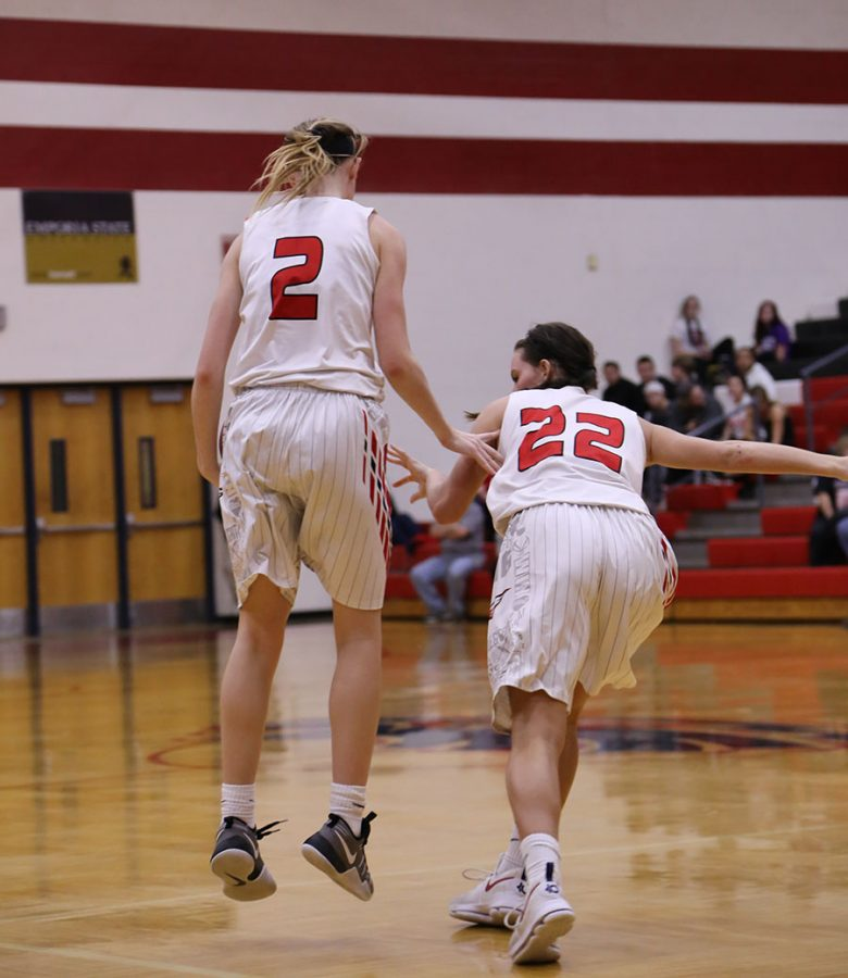 Seniors Brecken Roe and Taylor Holmes play the court. The girl's defeated Eisenhower in their first round of sub-state 54-27.