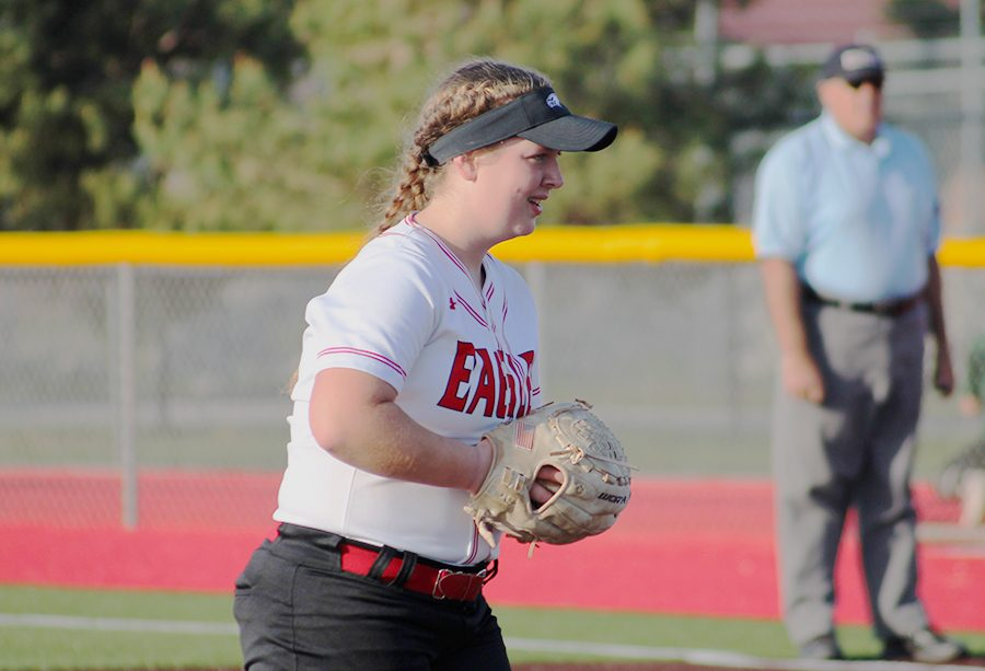 Junior Madi Arnold prepares for a pitch.  This is Arnold's second year as a varsity pitcher.