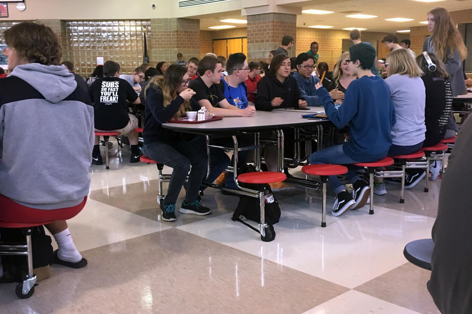 Students in B lunch eat at the new tables. The tables were added to the commons in the middle of June.