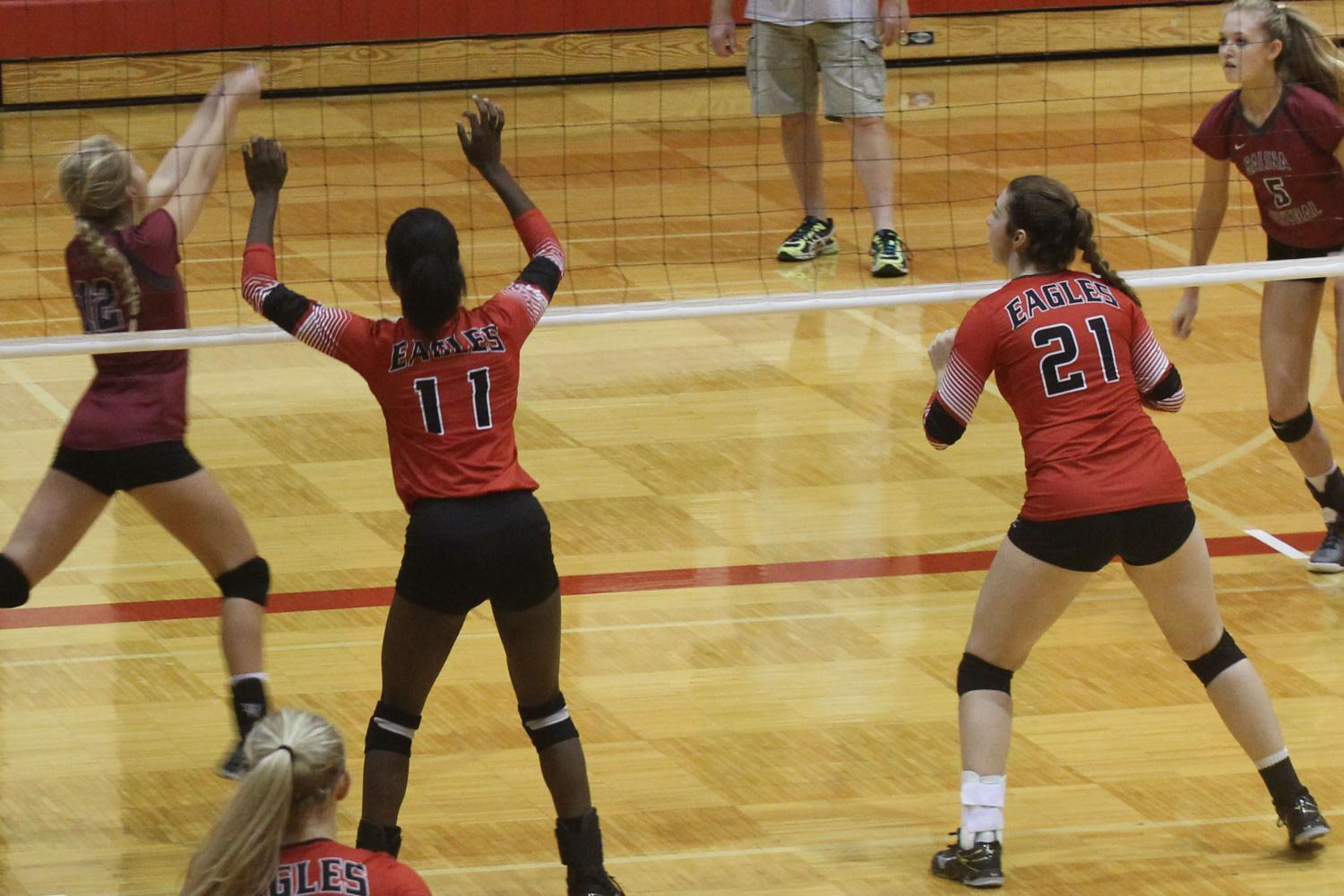 Seniors Autumn Hanna and Julianna Ledbetter play in one of last years volleyball matches.