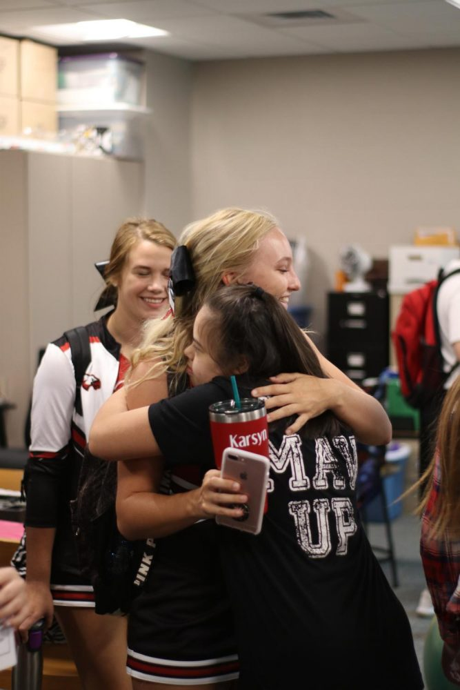 Senior Karsyn Buzard reunites with sophomore Hana Anees. Buzard said her favorite part was when Anees came up and hugged her.