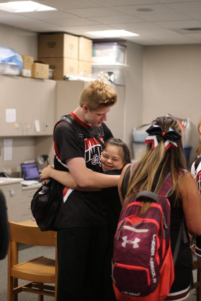 Sophomore Hana Anees gives junior Collin Lee a hug after not seeing him for a while.