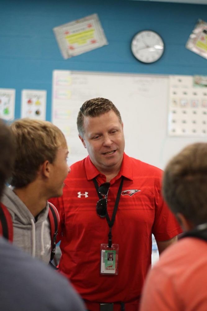 Principal Chris Botts talks with senior Brennen Sanders. Botts spent time at Maize south with friendship club.