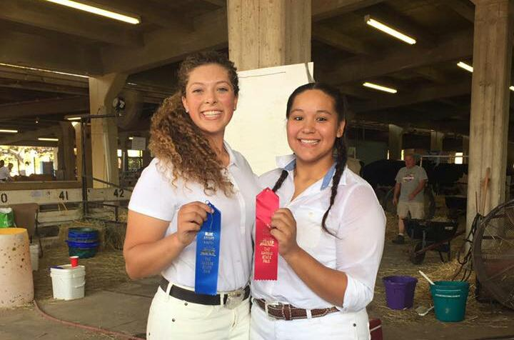 Seniors Brealand Booth(left) and Jasmine Choate hold up their awards.