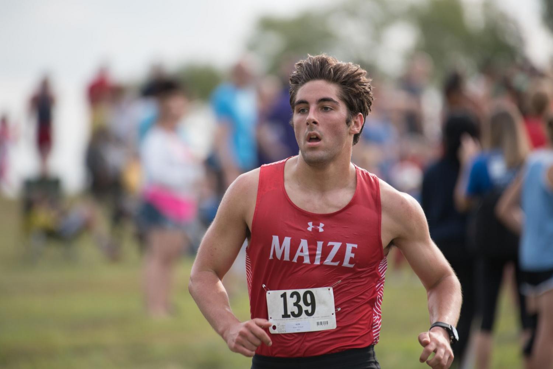 Senior Jake Ruder, running for the boys Cross Country Team.