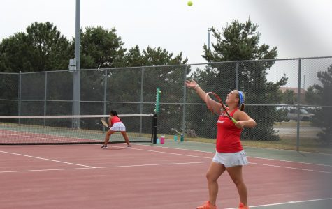 Maize tennis competes in quad at home