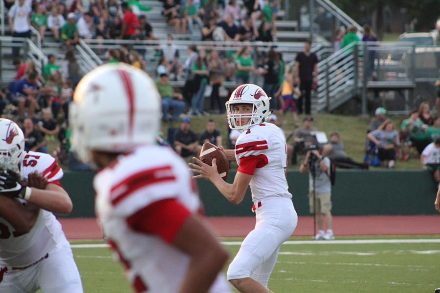 Junior quarterback Caleb Grill prepares to pass the ball. The Eagles fell to Derby 60-28.