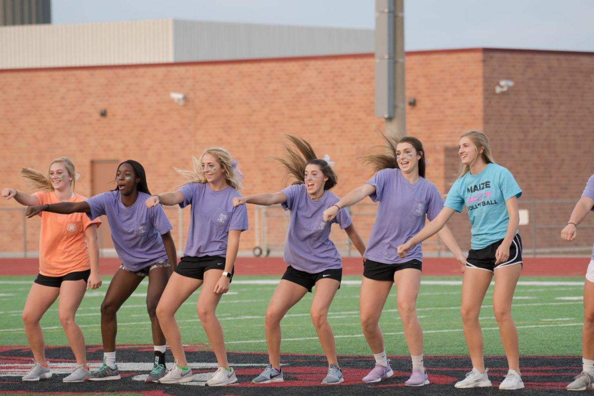The volleygirls danced during halftime at the powder puff game.