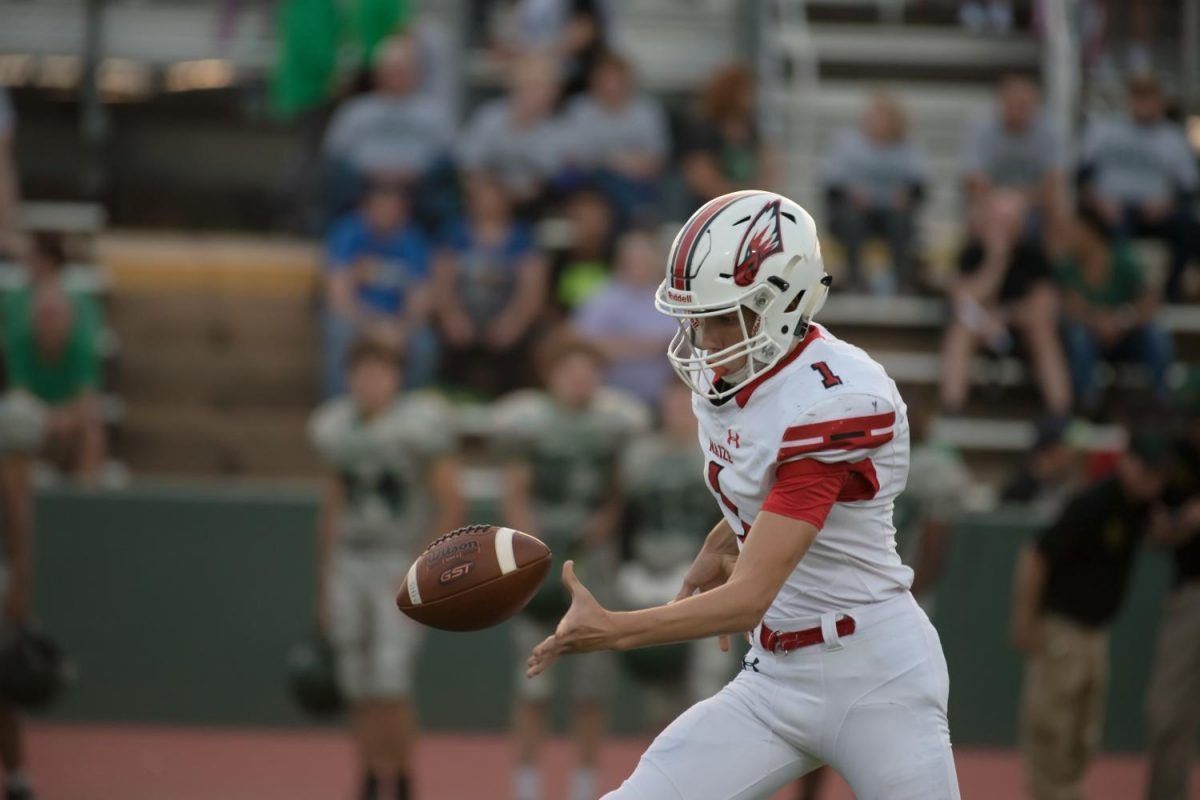 Junior Caleb Grill punts the ball. Maize defeated Ark City 21-7 on Friday.