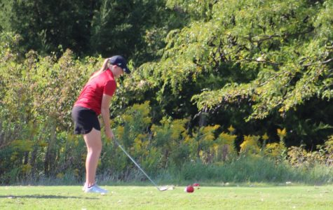 Hannah Scheuermann preparing to drive the ball at the Tex golf tournament.