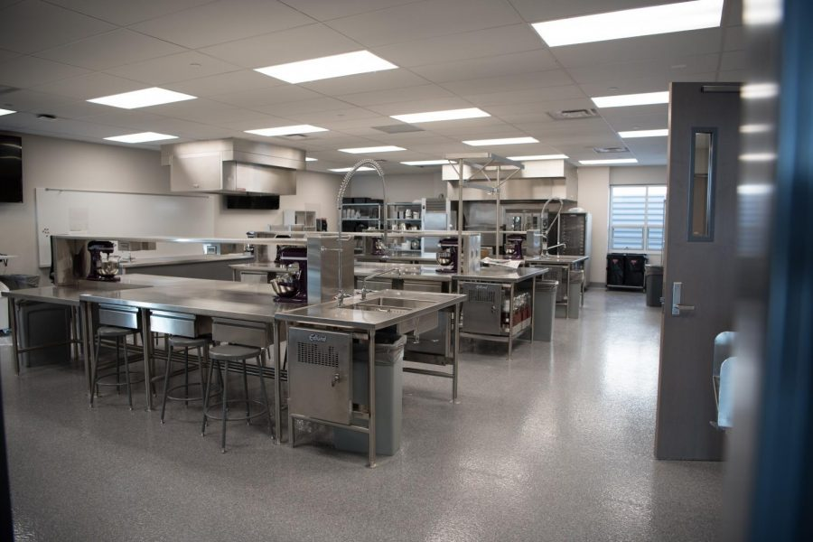 This is the new culinary arts room completely updated from the current ones. Culinary arts students are learning in a new state of the art cooking environment, with industrial level sinks and updated cooking equipment.