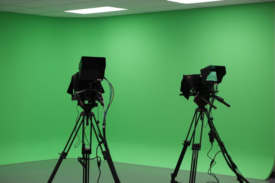 The new broadcasting room in the CTE building has a seamless green screen wall. The seamless wall provides a higher quality video broadcast picture.