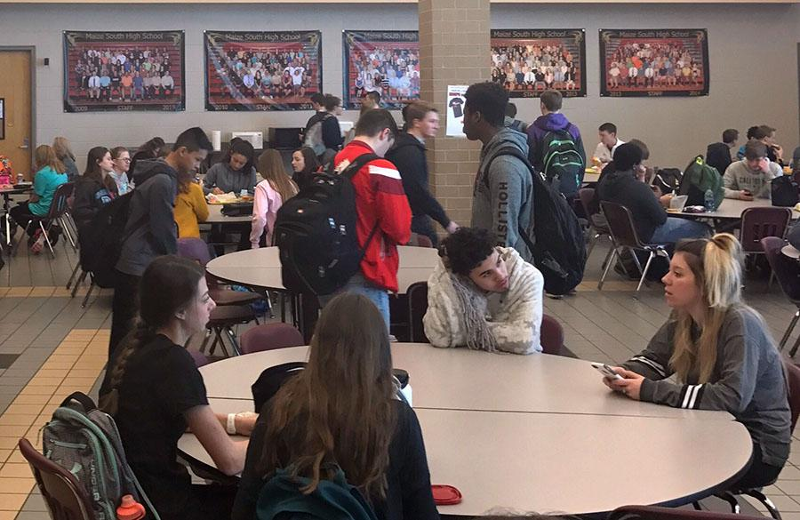 Students in the lunch room during an active shooter situation are suggested to run out of the building through the closest possible exits.