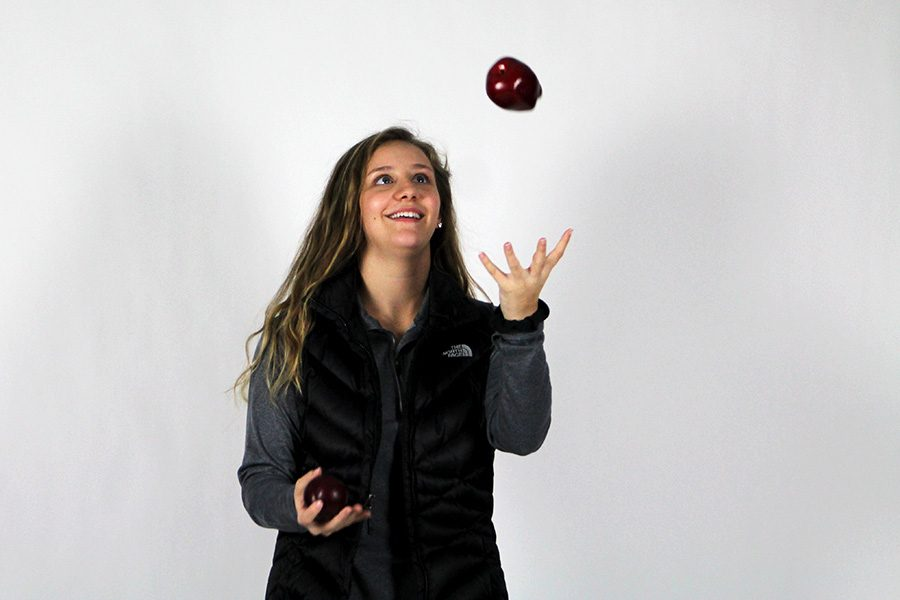 Senior Paige Young juggles with the benefits and struggles (and fruit)  of sticking to a New Year's resolution.