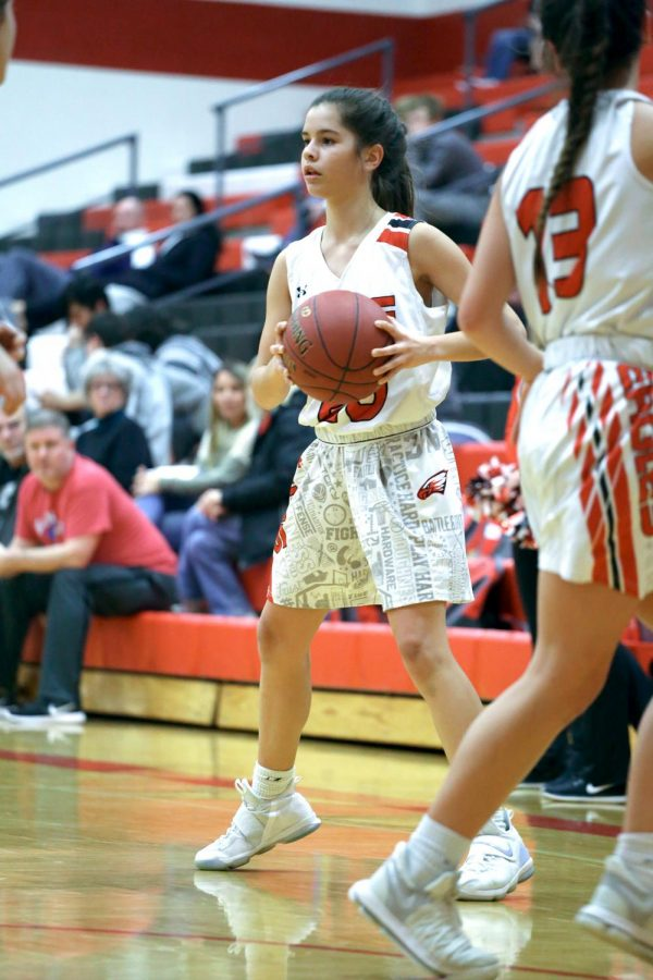 Freshman Kaylee Wilcox looks for a pass against Campus on Tuesday. Eagles won 58-21 against Campus.