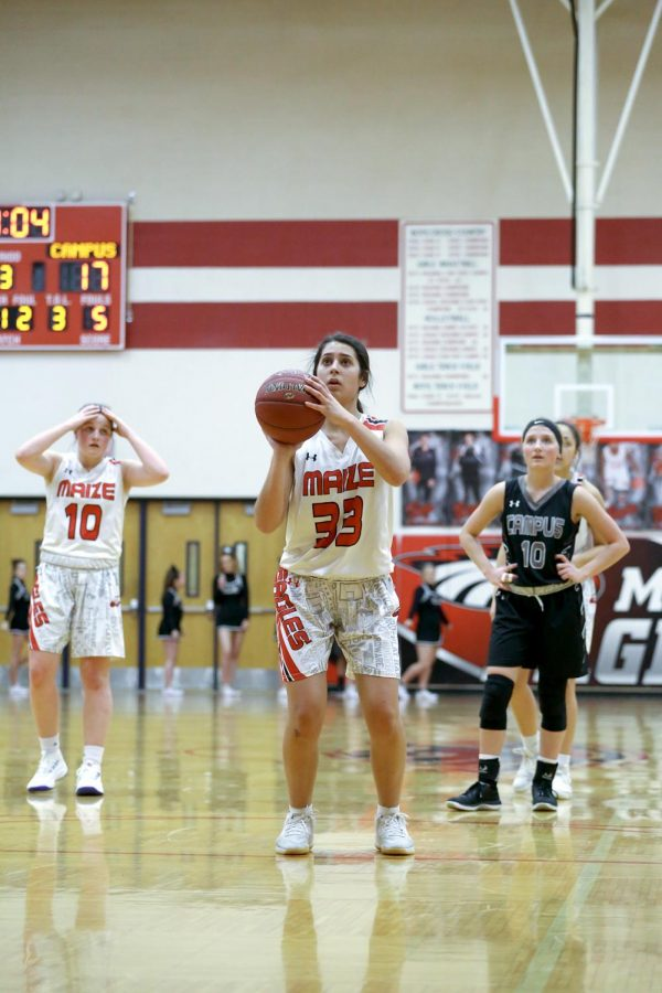 Sophomore Joscelyne Espinoza shoot at free throw against Campus on Tuesday. Eagles won 58-21 against Campus.